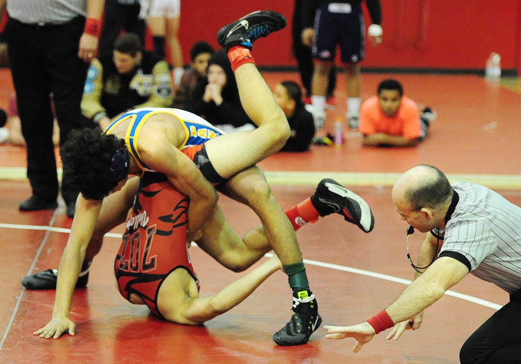. (CHRIS RILEY �TIMES-HERALD) Benicia\'s Eric Santos tries to pin Vallejo\'s Aadam Jaleel during their 145 pound match at the Solano County Athletic Conference finals in Vallejo on Friday. Santos eventually won by pinfall.