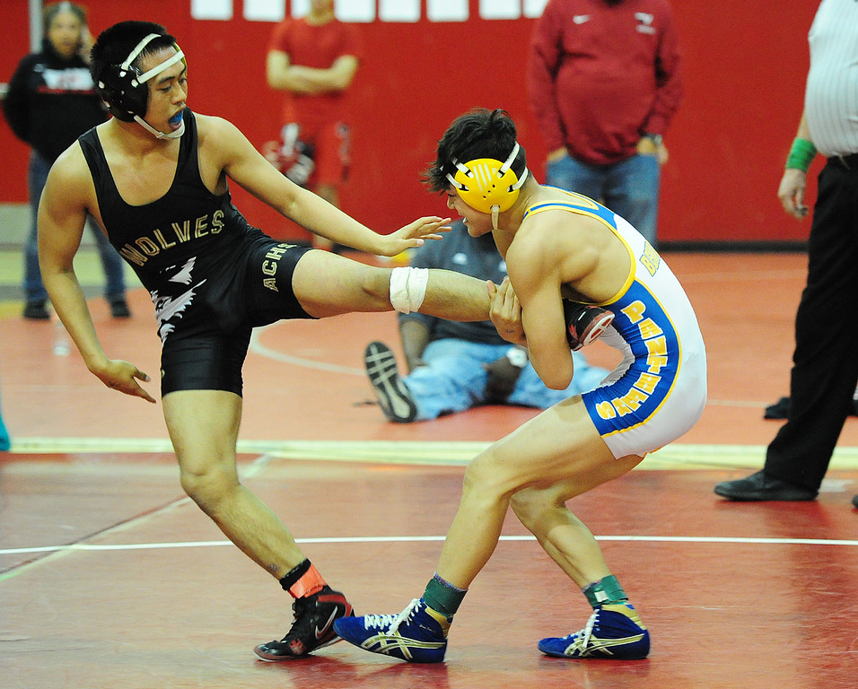 . (CHRIS RILEY �TIMES-HERALD) Benicia\'s Basil Othman pulls American Canyon\'s Aaron Villas Carlos during their 126 pound match at the Solano County Athletic Conference finals in Vallejo on Friday.