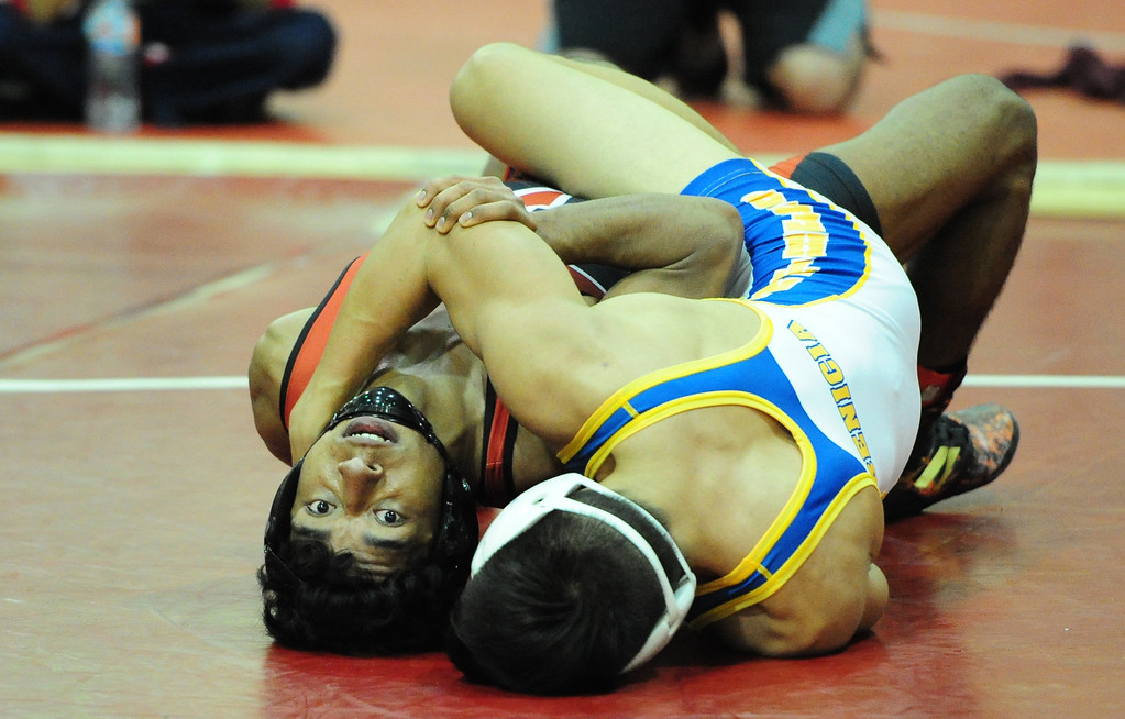 . (CHRIS RILEY �TIMES-HERALD) Vallejo\'s Jesus Guizar tries to escape the grasps of Benicia\'a Ryley Boutain during their 138 pound match at the Solano County Athletic Conference finals in Vallejo on Friday.