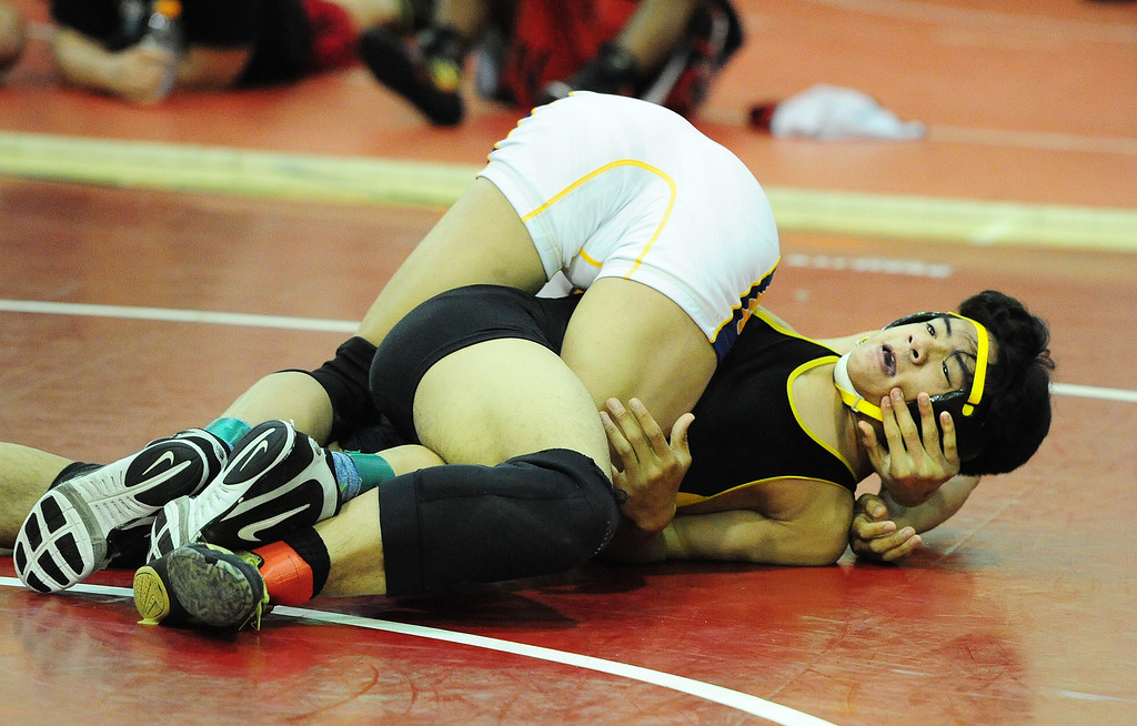 . (CHRIS RILEY �TIMES-HERALD) American Canyon\'s Aviyen Ferreira is wrapped up by Benicia\'s Steven Foy during their 120 pound match at the Solano County Athletic Conference finals in Vallejo on Friday.