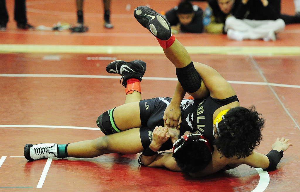 . (CHRIS RILEY �TIMES-HERALD) American Canyon\'s Zachary Ferrer squeezes Vallejo\'s Adrian Ocampo during their 120 pound match at the Solano County Athletic Conference finals in Vallejo on Friday.