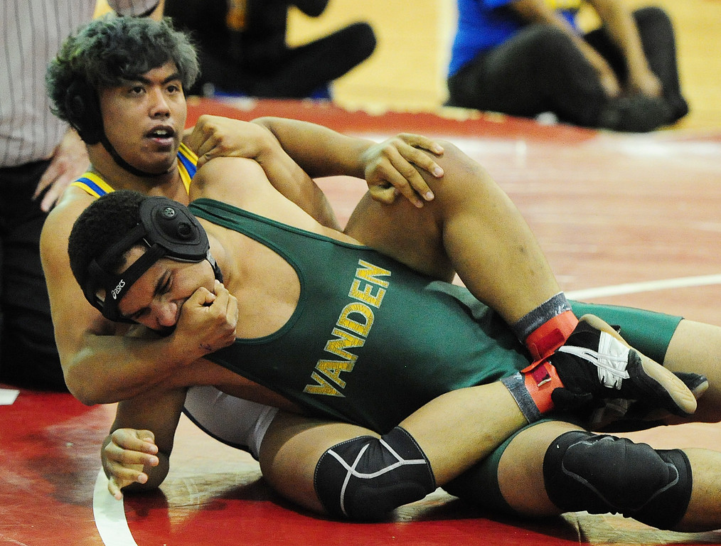 . (CHRIS RILEY �TIMES-HERALD) Benicia\'s Jayden Bocaling covers the face of Devin Adams from Vanden during their 195 pound match at the Solano County Athletic Conference finals in Vallejo on Friday.