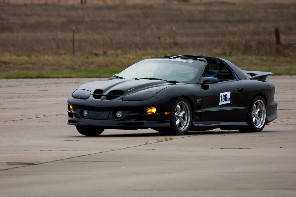 "This is my car which I labeled ""WS6ZXR"". You can see the badging on the side. The ground effects are by Wings West, the suspension is by Global West. I raced this car for a number of years in SCCA racing and out at Hallett Speedway. I may post some of the in-car racing videos here on the site when I get the chance. I won SCCA Regional championships with this car in 2001 and 2002 in Street Modified (SM) class."