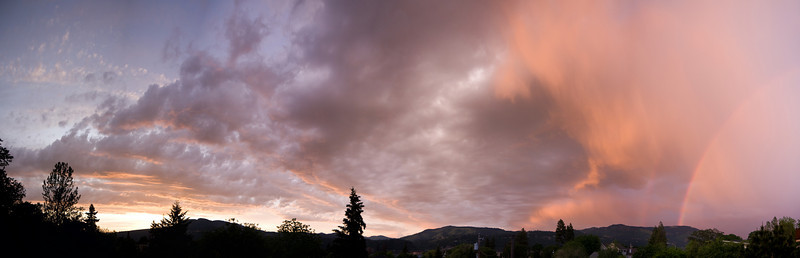 This is a 180˚, 8-shot panorama of a dramatic sunset featuring a double rainbow taken from the front deck of my house.<br /> <br /> Location: Hood River, Oregon<br /> <br /> Lens used: 17-55mm f2.8 IS