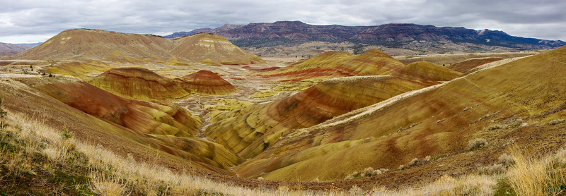 This is a 4-shot panorama stitched together in Photoshop CS3.<br /> <br /> Location: Painted Hills, Oregon<br /> <br /> Lens used: 17-55mm f2.8 IS
