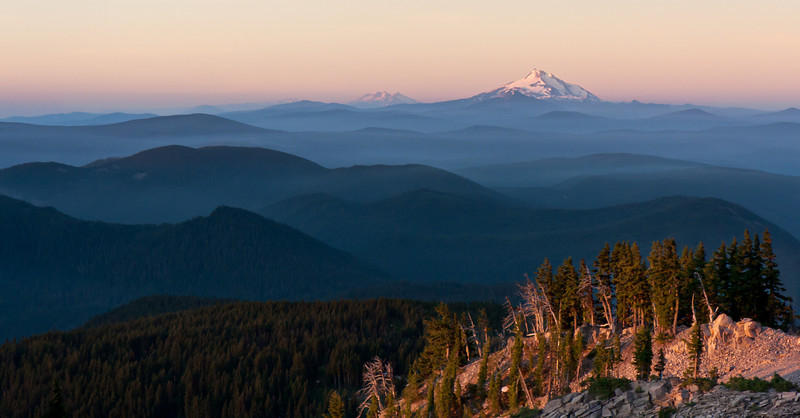 The view south along the Cascade crest towards Mt. Jefferson (near) and the Three Sisters (far) at sunrise from the southeast flank of Mt. Hood.<br /> <br /> Location: Top of Inner Limits, Mt. Hood Meadows ski area, Oregon<br /> <br /> Lens used: 17-55mm f2.8 IS
