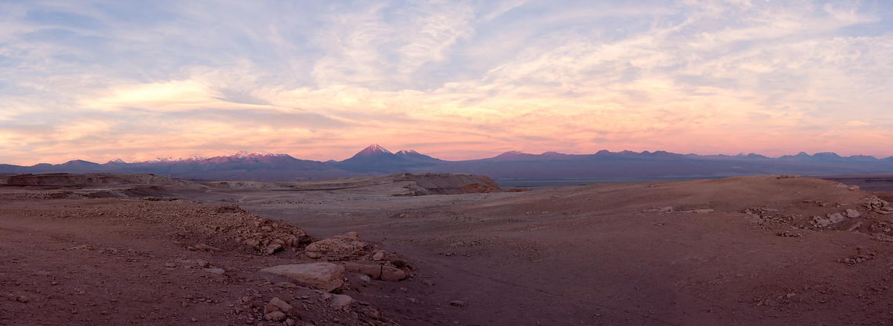 The view eastwards towards the Andean crest and the Bolivian border at sunset.<br /> <br /> This is a 16-shot panorama stitched together in Photoshop CS 5.<br /> <br /> Location: Near San Pedro de Atacama, Chile<br /> <br /> Lens used: Canon 17-55mm f2.8 IS