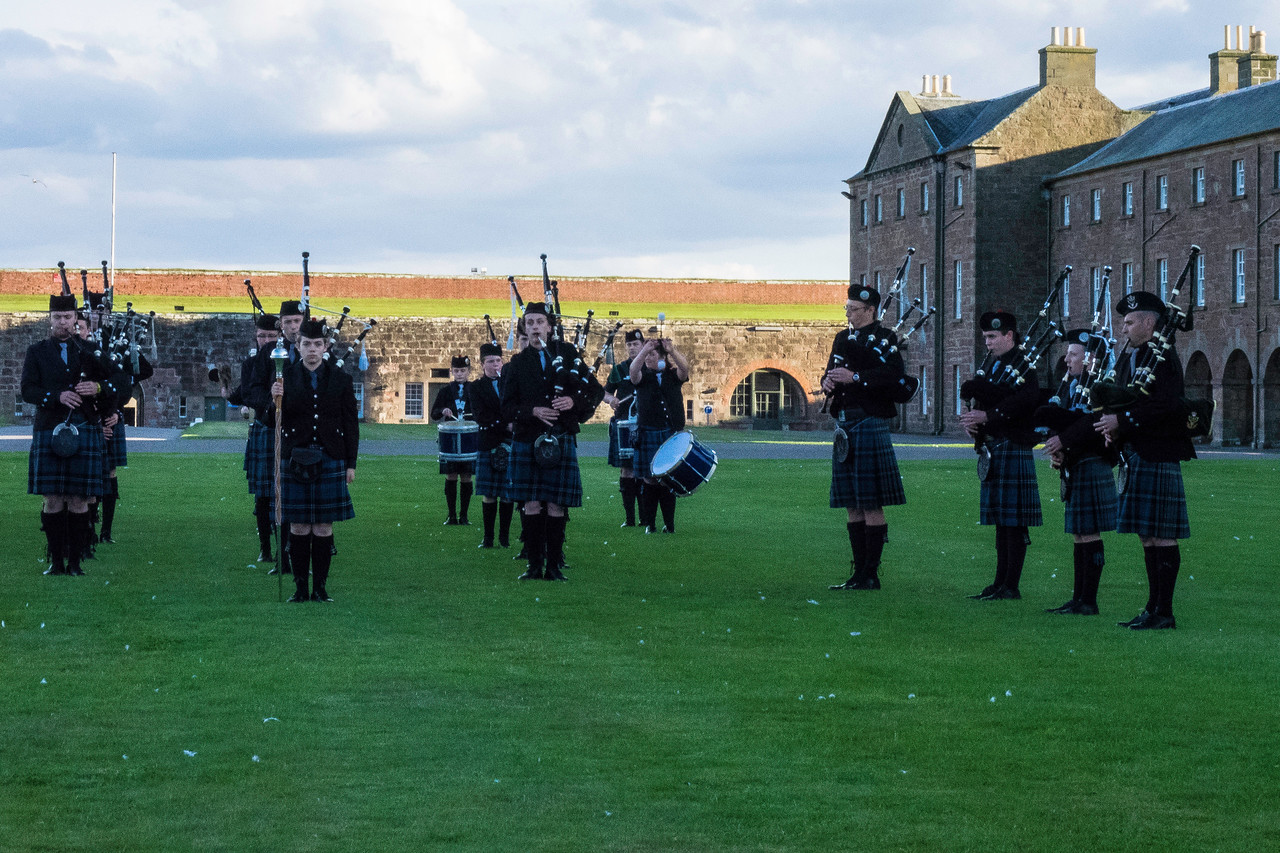 Inverness Junior Pipe and Drum corps performed retreat, calling in all of the sentries.  Aged 10 - 15, very serious and good