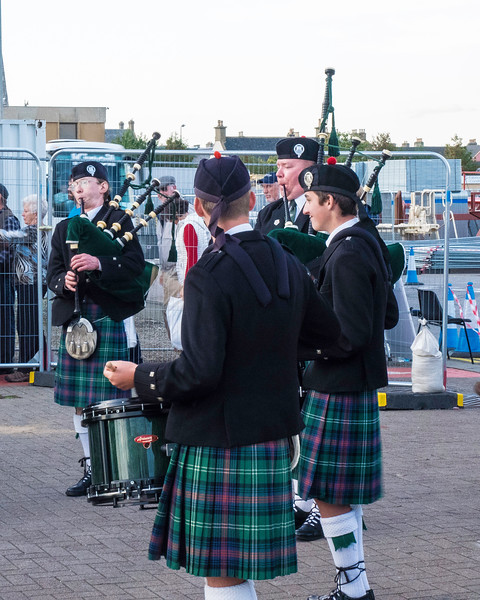 Invergordon junior pipers met us at the ship.