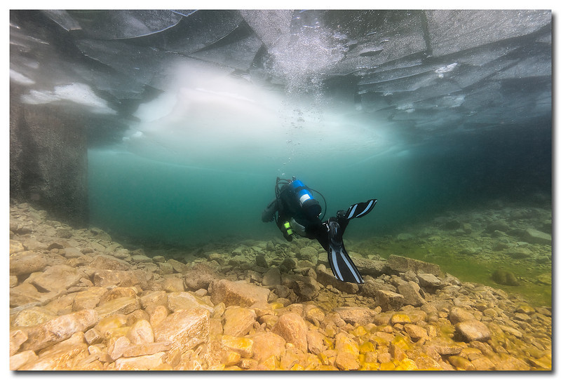 Ice Diving - Gills Rock, 15 ft. Deep<br /> <br /> Ice Diving is another diving activity that provides divers with improved visibility during the winter months.  Algae growth in the summer months reduces water visibility.  The extremely cold water prevents the typical algae growth during summer months.  A diver will dive in a 'drysuit' keeping him dry and warmer than a wetsuit.
