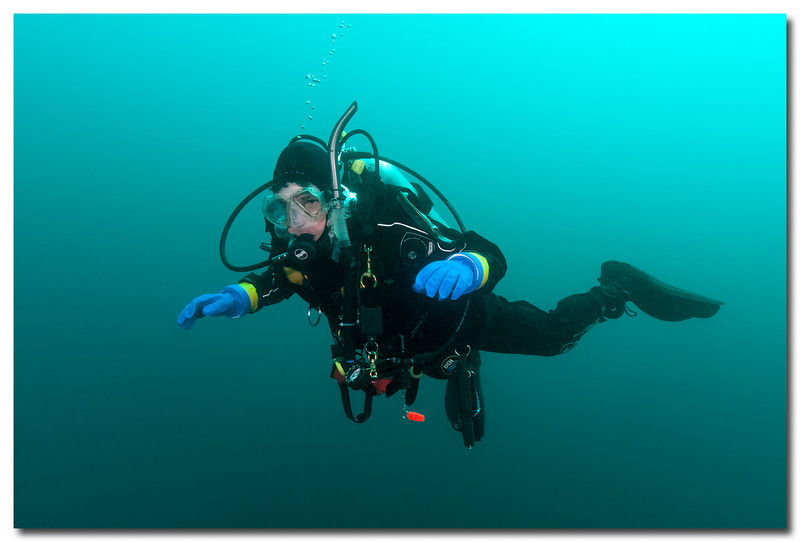 Peak Buoyancy - Lake Michigan<br /> <br /> A diver's ability to control their 'Buoyancy' is an important scuba diving skill.  Controlling one's buoyancy provides a diver with the ability to sink, hover or ascend.  And is controlled with added lead weights and compressed air injected into or released from a vest called the 'Buoyancy Compensator'.