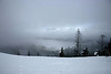 The SCWS Snow Outing was the occasion of the spreading of our friend Carey's ashes. This is the view from the point where they were spread, looking north over Lake Keechelus with the Cascade Mountains in the distance.<br> <i>photo by Jeff Manor</i>