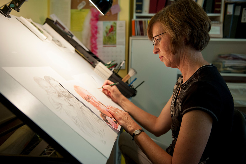 Artist Jean Keaton works on a drawing that features Christ in her home studio in Kaysville on August 23, 2014. Keaton recently made some drawings for the family of Marli Hamblin, who passed away recently after an accident in the driveway of her home in Syracuse. (ROBBY LLOYD/Standard-Examiner)