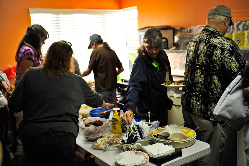 Concert-goers enjoy a pre-show potluck while they wait for the Zen Cowboy, Chuck Pyle, to perform at the Twitchell House Venue in Ogden on September 15, 2012. (LUCID IMAGES/Special to the Standard-Examiner)