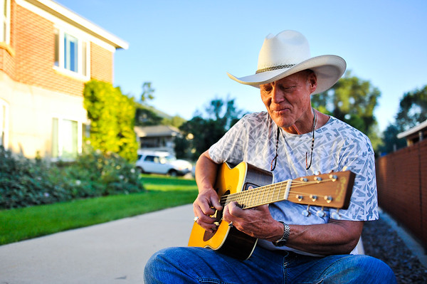 Chuck Pyle warming up before a house concert in Ogden on September 15, 2012. (LUCID IMAGES/Special to the Standard-Examiner)