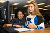 Erik Carino, a student advocate at Roy High, helps Celia Carrero, a sophomore, with math work during options class where students work to make up missed work at Roy High School in Roy on April 25, 2016.
