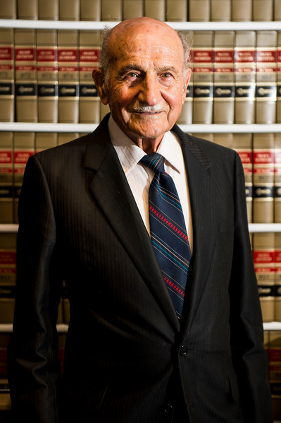 George Fadel poses for a photo inside of his law offices in Bountiful on July 11, 2016. Fade has brought suit against Farmington City over a sign that was on his property for over 50 years and was destroyed by Farmington in 2015.