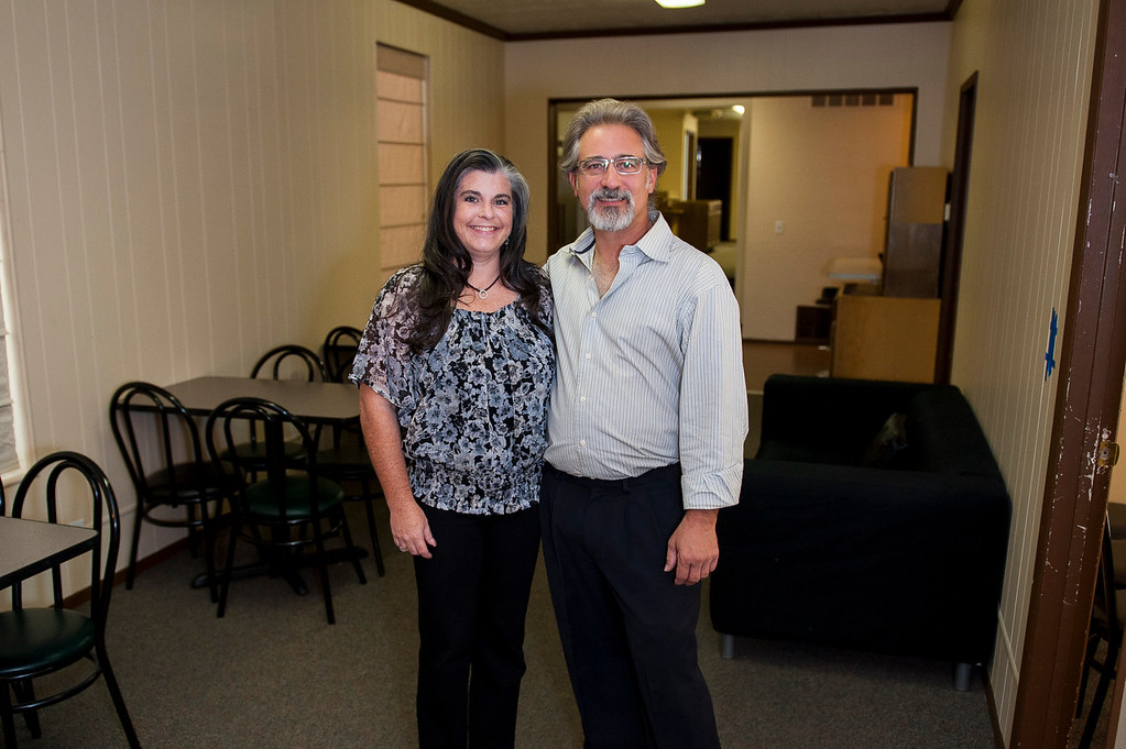 Kristen Mitchell and Scott Catuccio pose for a photo in the dining area of what will be Utah's first homeless shelter specifically for youth. The shelter will be able to accommodate 15 youth ages 12-17 when it is completed. Photo taken in Ogden on October 2, 2014.