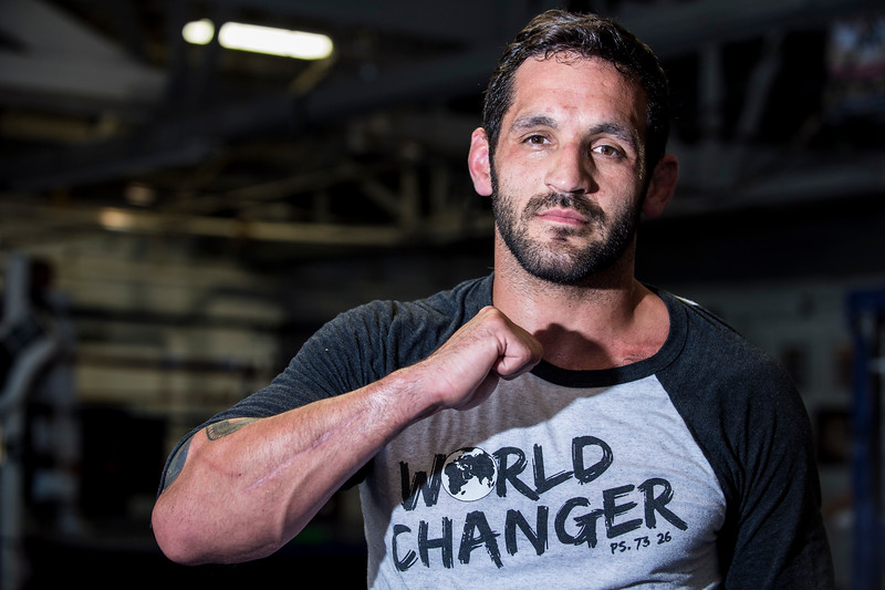 Lucus Montoya shows off his surgery scars while posing for a photo at Foley's Mixed Martial Arts Gym in Ogden on July 14, 2016. Montoya broke his arm during a fight and has been struggling to get consistently back in the ring after three surgeries to repair his ulna.