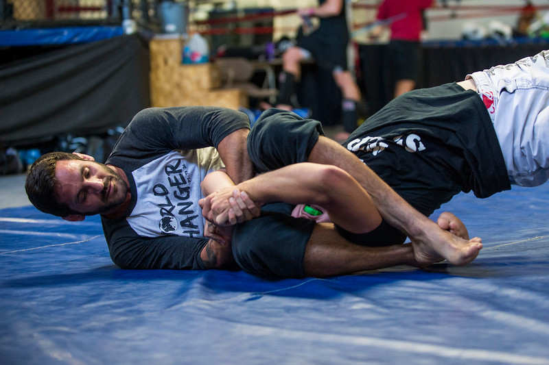 Lucus Montoya (left) works on his grappling skills with Colten Bybee (right) at Foley's Mixed Martial Arts Gym in Ogden on July 14, 2016. Montoya broke his arm during a fight and has been struggling to get consistently back in the ring after three surgeries to repair his ulna.