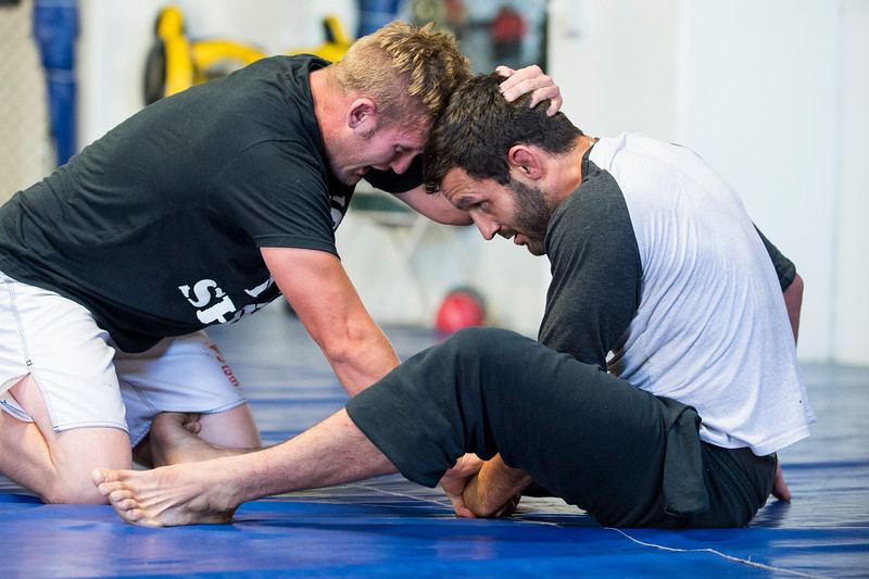 Lucus Montoya (right) works on his grappling skills with Colten Bybee (left) at Foley's Mixed Martial Arts Gym in Ogden on July 14, 2016. Montoya broke his arm during a fight and has been struggling to get consistently back in the ring after three surgeries to repair his ulna.