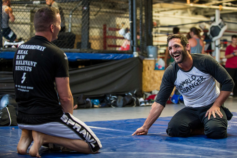 Lucus Montoya (right) talks with Tommy Clark (left) before working on their grappling skills at Foley's Mixed Martial Arts Gym in Ogden on July 14, 2016. Montoya broke his arm during a fight and has been struggling to get consistently back in the ring after three surgeries to repair his ulna.