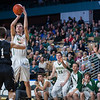Nashoba's Andrew Fish goes up for a 3 pointer in the 4th quarter as the bench reacts. SENTINE&ENTERPRISE/ Jim Marabello