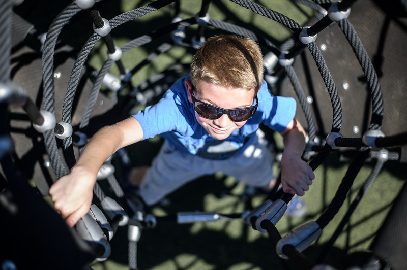 6/17/16 LEOMINSTER with story-- Vinnie Boyd, 8, of Leominster climbs up one of the parks new attractions during Fridays grand re-opening of the Louis Charpentier Park in Leominster.   Sentinel & Enterprise photo/Jeff Porter