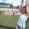 6/17/16 LEOMINSTER with story--Allie Bouchard, 10, of Leominster rides the new zip line which sits in the middle of  the Louis Charpentier Park in Leominster as Logan LeBlanc, 3, of Fitchburg runs behind.   Sentinel & Enterprise photo/Jeff Porter