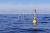 floating yellow beacon blue sea ocean