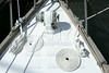 sailboat white bow with bollard and spiral rope