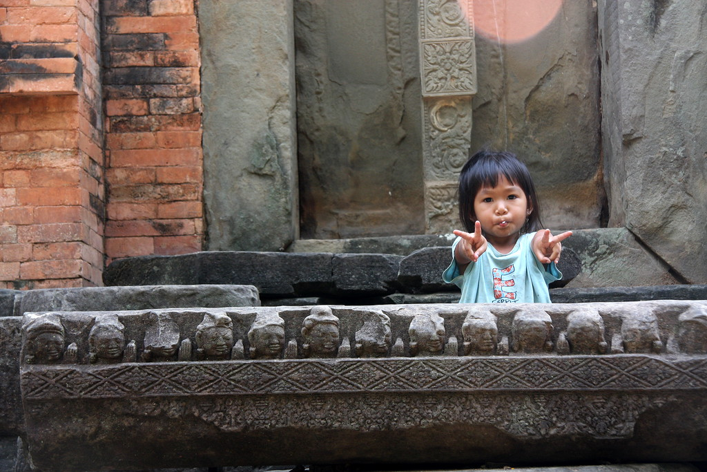 little boy sitting at Lolie Temple, Angkor Wat