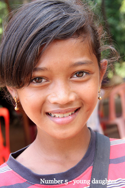 This charming young lady works with her parents at restaurant # 5. Preah Neak Pean is a late 12th century Buddhist temple consisting mainly of a large quadratic pool with an island with a tower at its centre.