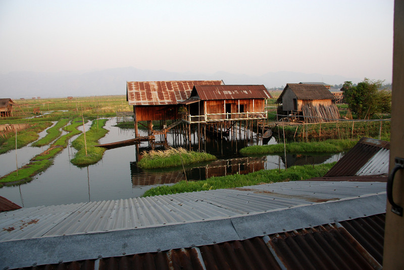 Family of our boat guide at their home on the Lake.Inle Lake, Myanmar, a beautiful place you can easily spends weeks enjoying!  March 2009