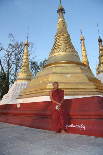 """Our friendly guide, we would meet him again a few weeks later while walking the streets of Yangon. The """"Golden"""" Shwedagon Pagoda in Yangon, Myanmar,  March 2009 Yangon"""