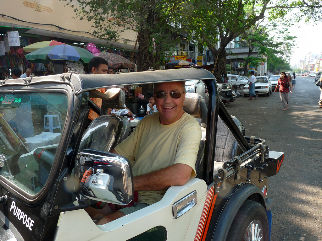 "I went up to the driver of the Jeep knock-off and asked if I could drive it, he graciously said ""yes"" and I drove around Yangon for about 30mins enjoying the atmosphere and the stares!  Can you image someone in the US, doing this with a stranger? Yangon, Myanmar,  March 2009"