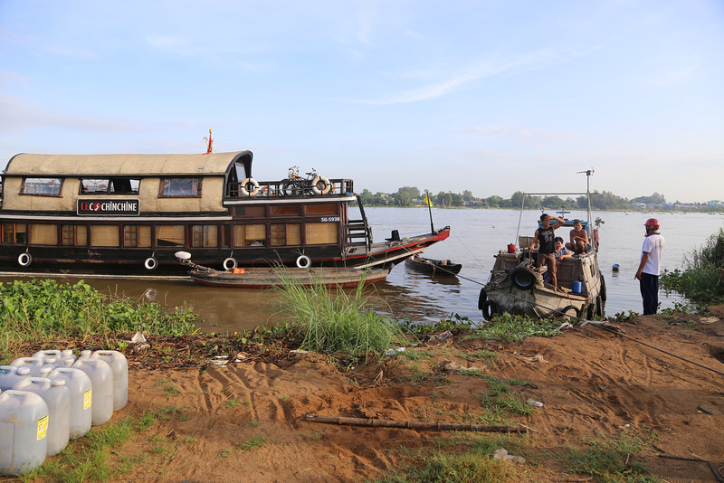 The small family working river boat (on right) awaits us, . A family of 4 lives on this boat. Nov 2013