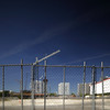 Tilt shift image of a fence by a construction site