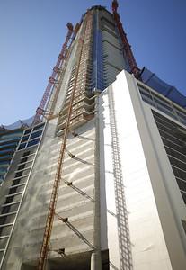Building with cranes under construction