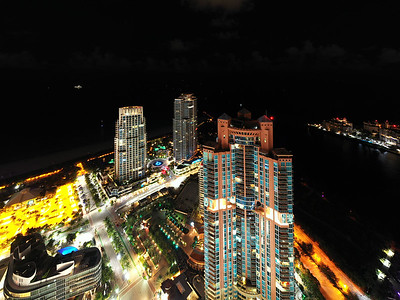Aerial drone photo Miami Beach highrise towers at night