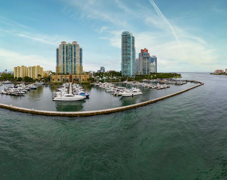 Aerial photo Miami Beach Marina perimeter dock luxury yachts in boat slips