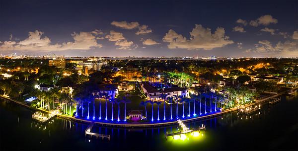 Luxury Miami Beach mansions neon lights at night