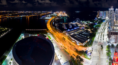 Night aerial scene Downtown Miami FL over American Airline Arena view of Bayside and port