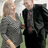 KEVIN HARVISON | Staff photo<br /> Bobby Cantrell, McAlester High School Hall of Fame indictee, right, visits with Gail Painter during a meet and greet inside the indoor practice facility Friday.