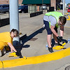 KEVIN HARVISON | Staff photo<br /> Volunteers work togather on Carl Albert Parkway. Volunteers painted curbs and fire hydrants from Main Street to Sixth Street on Choctaw Avenue and West Street to Tandy Town on Carl Albert Parkway along with portions of Washington Avenue.
