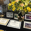 KEVIN HARVISON | Staff photo<br /> A table of momentos sits with the McAlester Athletic Hall of Fame for Lawson Giddings III.