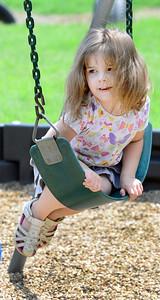 KEVIN HARVISON | Staff photo Amaya Reeder balances on a swing while enjoying the warm weather.