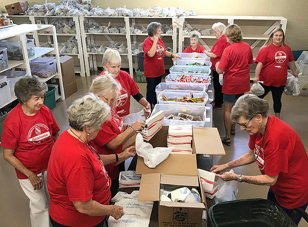 KEVIN HARVISON | Staff photo<br /> Fifteen Pittsburg county Chapter AARP members and guests participated in a State and Nation wide AARP Make a Difference Day by working with the local Shared Blessings organization. The group packed 452 snack packs for nutrition needy children to take home on the weekend. The project included a total of 1,300 pounds of food. AARP sponsors the observance annually on September 11 in memory of those who lost their lives in terrorist attacks on that day. The day also honors the memory of Dr. Ethel Andrus Percy, founder of AARP, who believed in community service, feeding the hungry, financial security for seniors and health care for all. One of her mottos stressed that seniors strive to serve, not be served. The local chapter meets monthly on the third MOnday at 10:30 a.m. at Western Sizzlin. Visitors are welcomed.