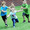 KEVIN HARVISON | Staff photo<br /> Jefferson Early Childhood Center students pictured from left, Jase Rees, Maddilynn Nichols and Malichi Taunton, get to the imaginary finish line during a recess race.