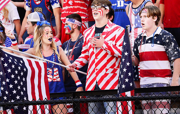 KEVIN HARVISON | Staff photo<br /> Many of the McAlester High School Student Section supported an American theme Friday night during the varsity football game against Ardmore at Hook Eales Stadium.